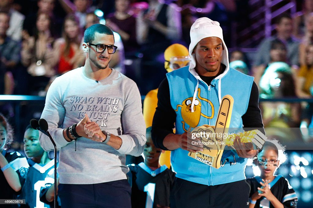 Co-host Cam Newton (R) and Colin Kaepernick speak onstage during Cartoon Network's fourth annual Hall of Game Awards at Barker Hangar on February 15, 2014 in Santa Monica, California.