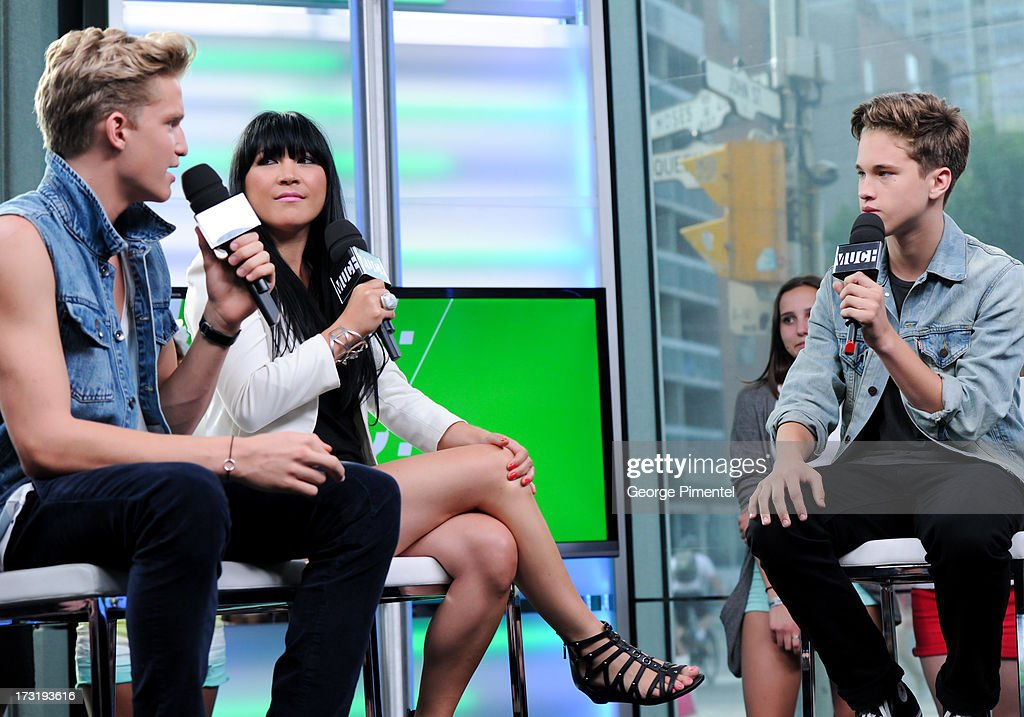 Co-host Cody Simpson, host Lauren Toyota and Ryan Beatty on NEW.MUSIC.LIVE. at MuchMusic Headquarters on July 9, 2013 in Toronto, Canada.