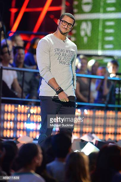 Cohost Colin Kaepernick speaks onstage during Cartoon Network's fourth annual Hall of Game Awards at Barker Hangar on February 15 2014 in Santa...