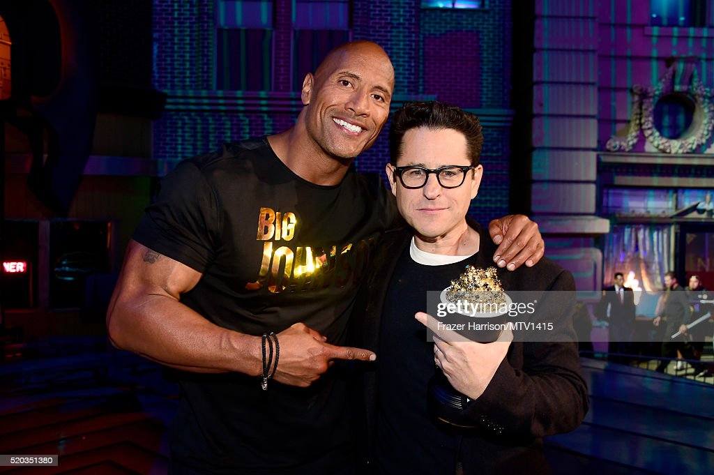 Co-host Dwayne Johnson (L) and director J.J. Abrams, winner of the Movie of the Year award for 'Star Wars: The Force Awakens,' pose during the 2016 MTV Movie Awards at Warner Bros. Studios on April 9, 2016 in Burbank, California. MTV Movie Awards airs April 10, 2016 at 8pm ET/PT.