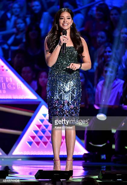Cohost Gina Rodriguez speaks onstage during the Teen Choice Awards 2015 at the USC Galen Center on August 16 2015 in Los Angeles California