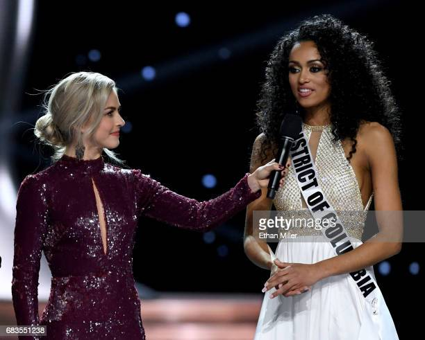 Cohost Julianne Hough looks on as Miss District of Columbia USA 2017 Kara McCullough answers a question during the interview portion of the 2017 Miss...