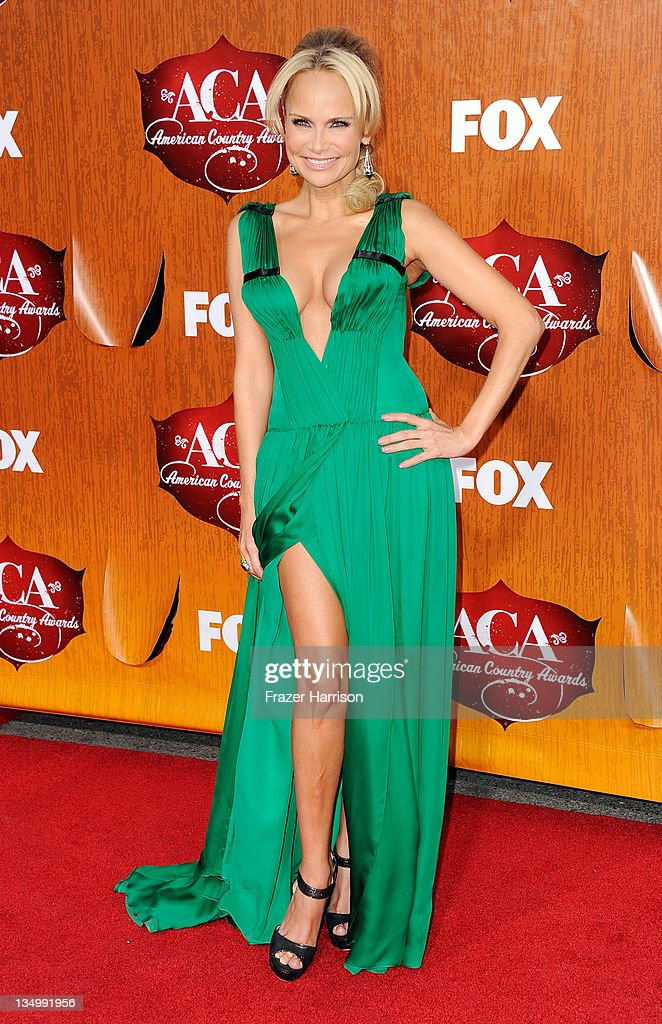 Co-host Kristin Chenoweth arrives at the American Country Awards 2011 at the MGM Grand Garden Arena on December 5, 2011 in Las Vegas, Nevada.