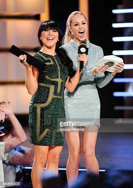 MMVA cohost Lauren Toyota and Laura Vandervoort at the 2014 Much Music Video Awards at Much HQ on June 15 2014 in Toronto Canada
