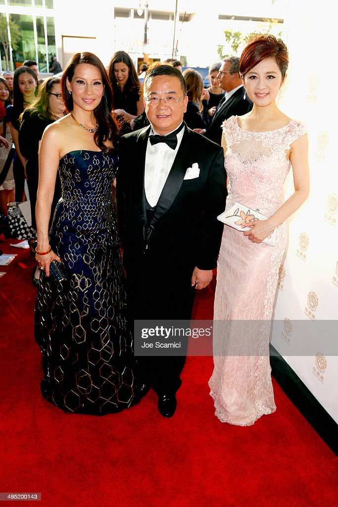 Co-host <a gi-track='captionPersonalityLinkClicked' href=/galleries/search?phrase=Lucy+Liu&family=editorial&specificpeople=201874 ng-click='$event.stopPropagation()'>Lucy Liu</a>, Chairman of Global Talents Media Group Wang Kun and co-host <a gi-track='captionPersonalityLinkClicked' href=/galleries/search?phrase=Olivia+Xu&family=editorial&specificpeople=12752321 ng-click='$event.stopPropagation()'>Olivia Xu</a> attend the Huading Film Awards on June 1, 2014 at Ricardo Montalban Theatre in Los Angeles, California. Huading Film Awards is China's #1 Film awards, in the U.S. for the first time.