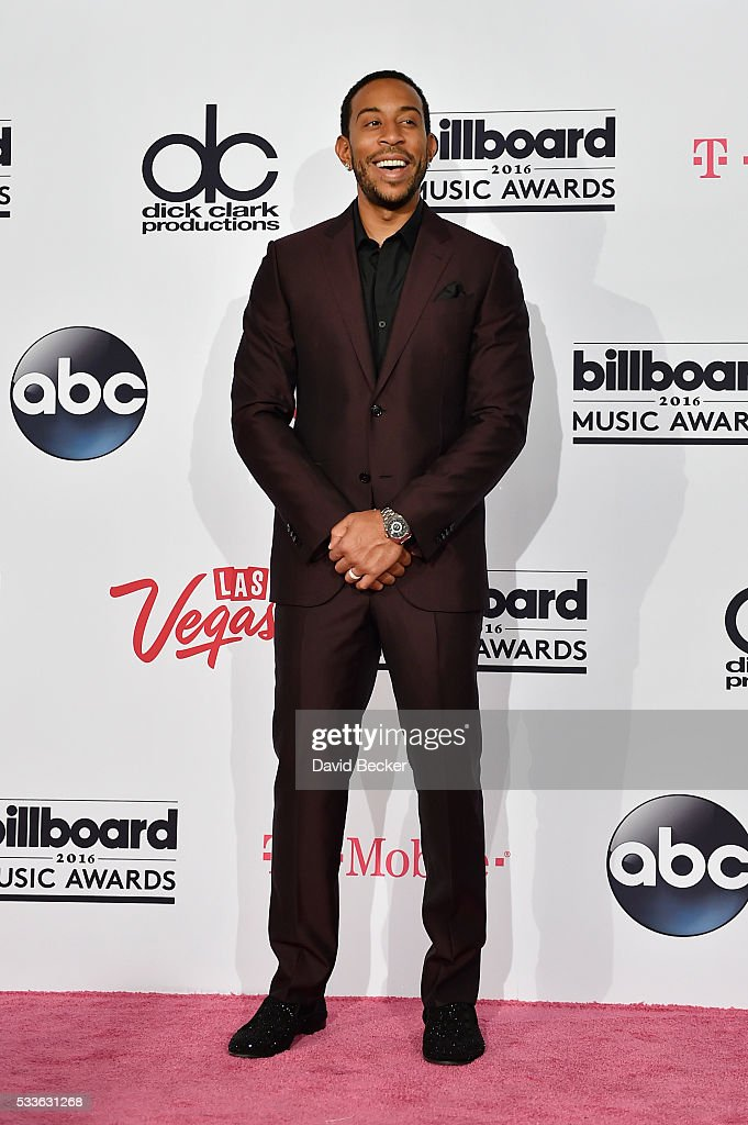 cohost-ludacris-poses-in-the-press-room-during-the-2016-billboard-picture-id533631268