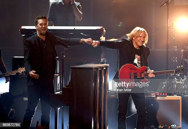 Cohost Luke Bryan and recording artist Joe Walsh perform onstage during the 52nd Academy of Country Music Awards at TMobile Arena on April 2 2017 in...