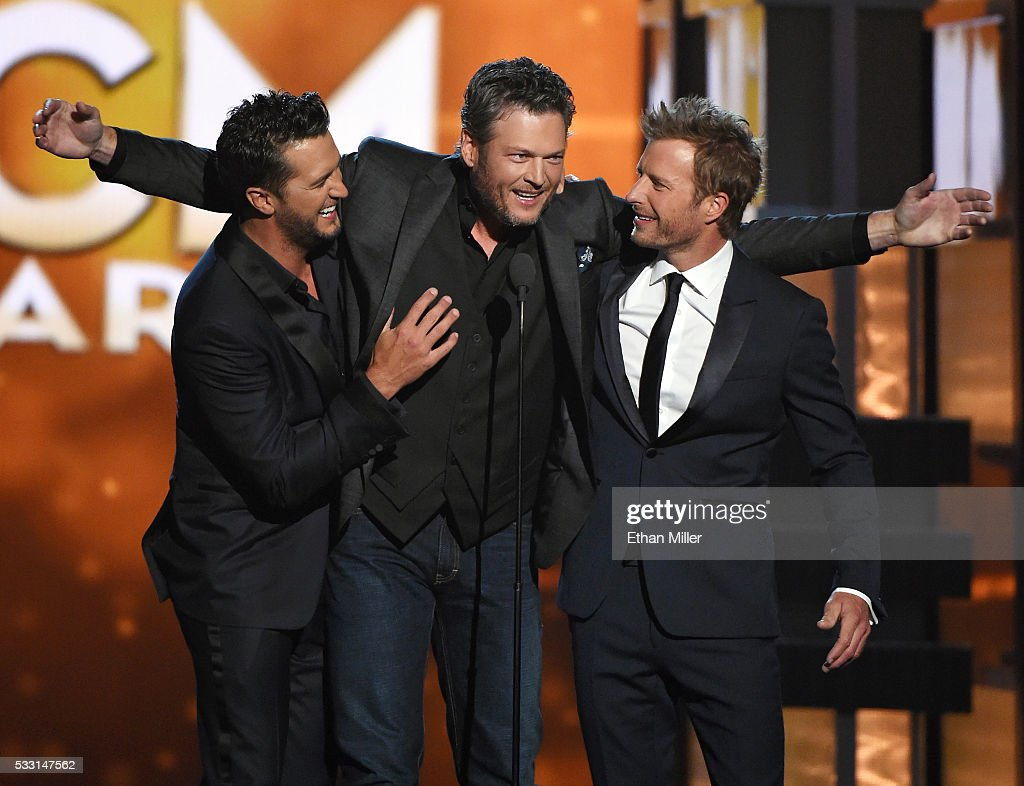 Co-host Luke Bryan, recording artist Blake Shelton, and co-host Dierks Bentley speak during the 51st Academy of Country Music Awards at MGM Grand Garden Arena on April 3, 2016 in Las Vegas, Nevada.