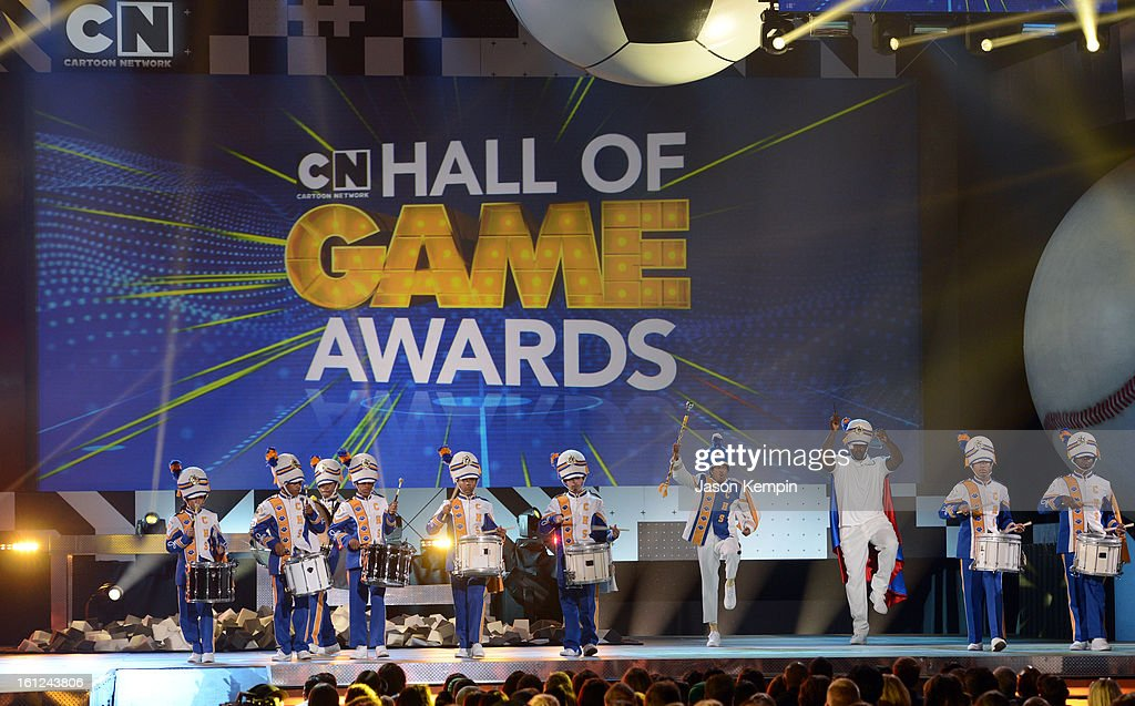 Co-host Nick Cannon and host Shaquille O'Neal march in place onstage during the Third Annual Hall of Game Awards hosted by Cartoon Network at Barker Hangar on February 9, 2013 in Santa Monica, California. 23270_003_JK_0216.JPG