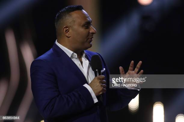 Cohost Russel Peters speaks during the JUNO Awards at the Canadian Tire Centre in Ottawa Ontario on April 2 2017 / AFP PHOTO / Lars Hagberg