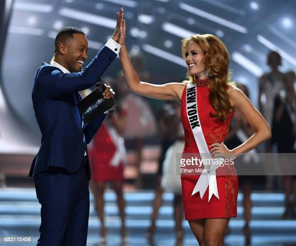 Cohost Terrence J highfives Miss New York USA 2017 Hannah Lopa after she was named a top 10 finalist during the 2017 Miss USA pageant at the Mandalay...
