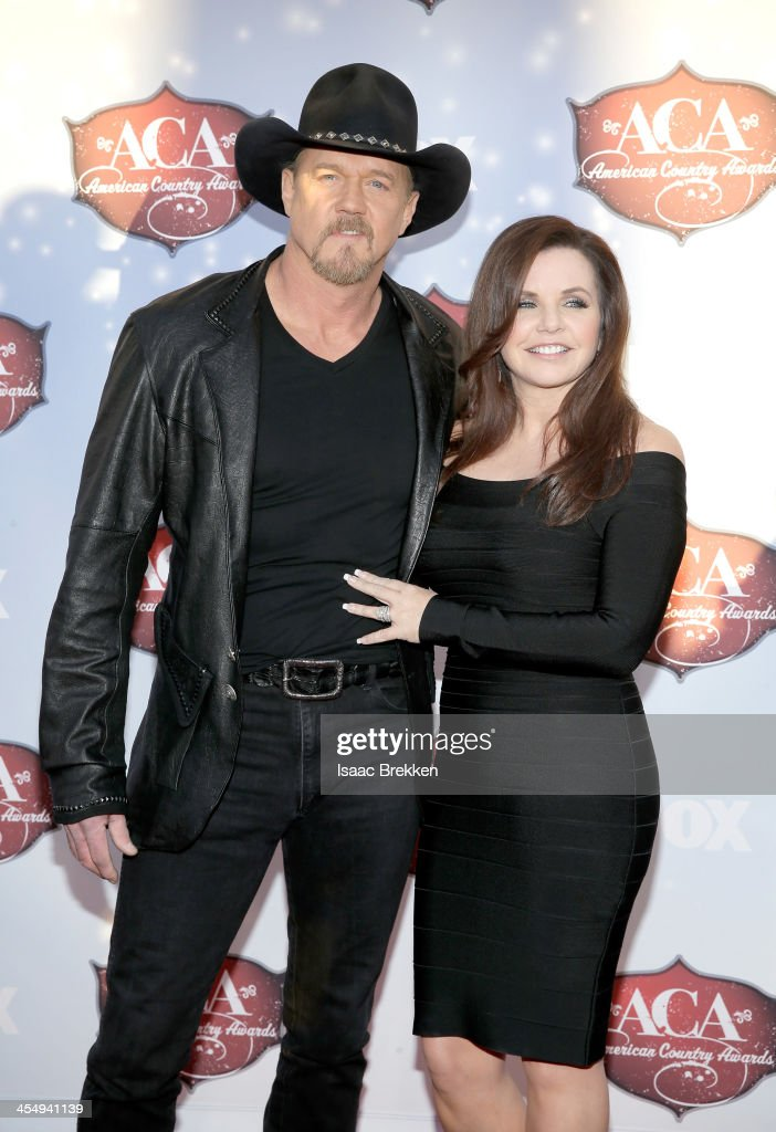 Co-Host <a gi-track='captionPersonalityLinkClicked' href=/galleries/search?phrase=Trace+Adkins&family=editorial&specificpeople=224686 ng-click='$event.stopPropagation()'>Trace Adkins</a> (L) and Rhonda Forlaw arrive at the American Country Awards 2013 at the Mandalay Bay Events Center on December 10, 2013 in Las Vegas, Nevada.