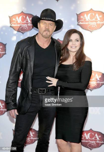 CoHost Trace Adkins and Rhonda Forlaw arrive at the American Country Awards 2013 at the Mandalay Bay Events Center on December 10 2013 in Las Vegas...