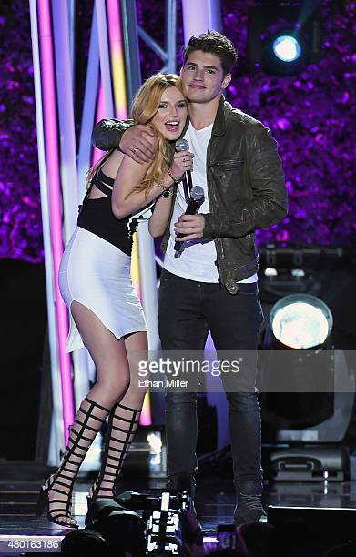 Cohost/actress Bella Thorne and actor Gregg Sulkin speak onstage during the MTV Fandom Fest San Diego ComicCon at PETCO Park on July 9 2015 in San...