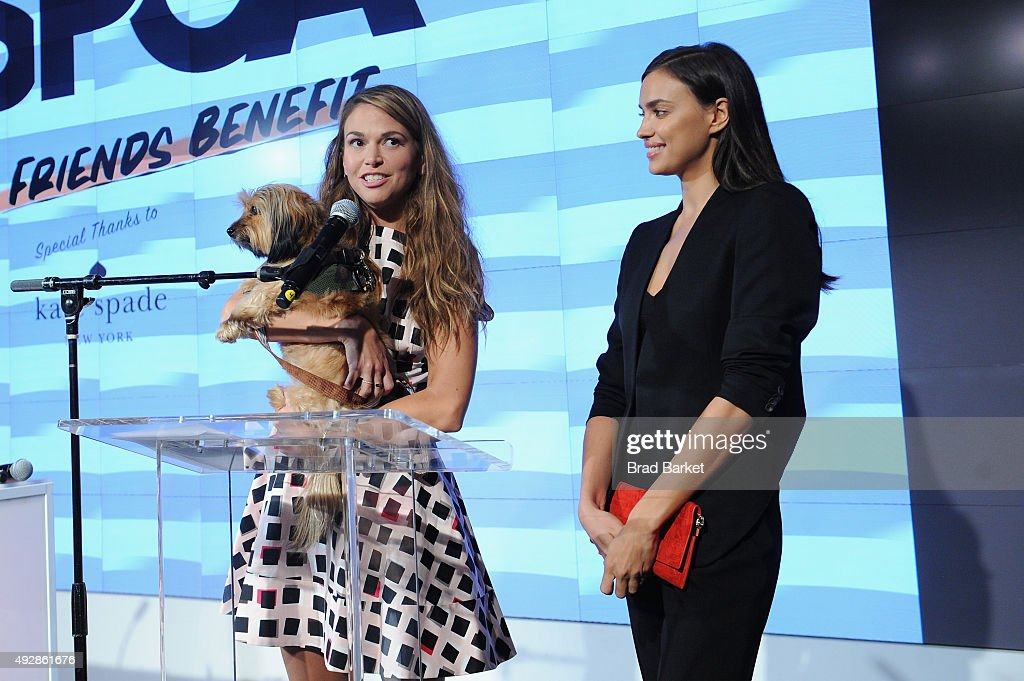 Cohosts actress Sutton Foster and model Irina Shayk speak during the ASPCA Young Friends benefit at IAC Building on October 15 2015 in New York City