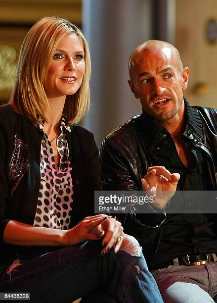 Cohosts and judges of 'Germany's Next Topmodel' model Heidi Klum and Peyman Amin watch contestants put on a fashion show during a taping of the...