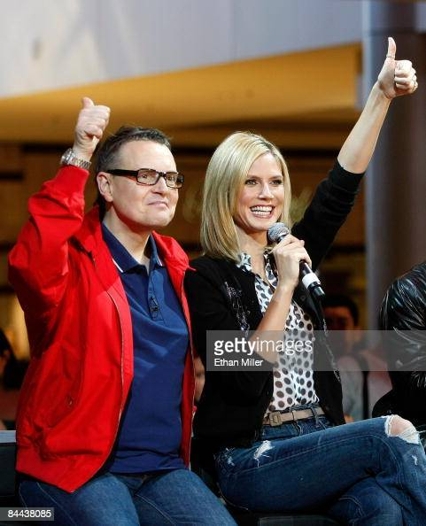 Cohosts and judges of 'Germany's Next Topmodel' Rolf Scheider and model Heidi Klum react after watching contestants put on a fashion show during a...