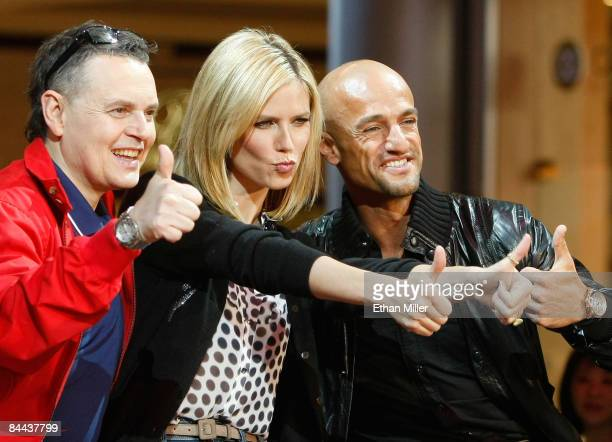 Cohosts and judges of 'Germany's Next Topmodel' Rolf Scheider model Heidi Klum and Peyman Amin joke around during a taping of the television show at...