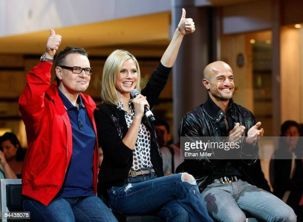 Cohosts and judges of 'Germany's Next Topmodel' Rolf Scheider model Heidi Klum and Peyman Amin react after watching contestants put on a fashion show...