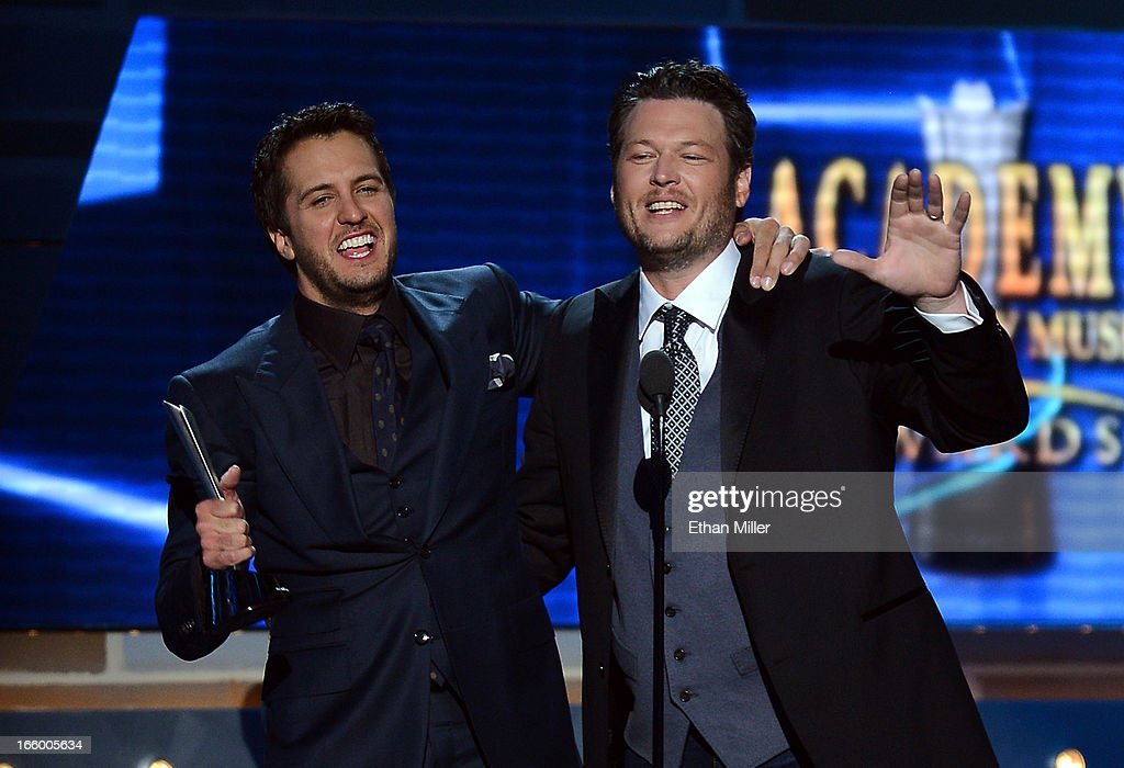 Co-hosts and recording artists <a gi-track='captionPersonalityLinkClicked' href=/galleries/search?phrase=Luke+Bryan&family=editorial&specificpeople=4001956 ng-click='$event.stopPropagation()'>Luke Bryan</a> (L) and <a gi-track='captionPersonalityLinkClicked' href=/galleries/search?phrase=Blake+Shelton&family=editorial&specificpeople=2352026 ng-click='$event.stopPropagation()'>Blake Shelton</a> speak onstage after Bryan accepted the Entertainer of the Year award during the 48th Annual Academy of Country Music Awards at the MGM Grand Garden Arena on April 7, 2013 in Las Vegas, Nevada.