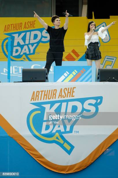 Cohosts and singers Alex Aiono and Sofia Carson perform at the USTA Billie Jean King National Tennis Center on August 26 2017 in the Queens borough...