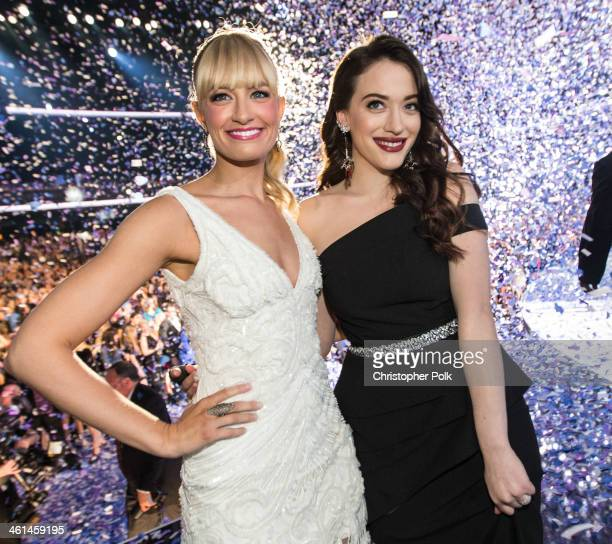 Cohosts Beth Behrs and Kat Dennings pose onstage during The 40th Annual People's Choice Awards at Nokia Theatre LA Live on January 8 2014 in Los...
