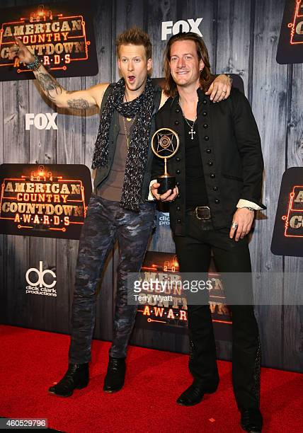 Cohosts Brian Kelley and Tyler Hubbard of Florida Georgia Line winners of the Group/Duo of the Year award pose in the press room during the 2014...