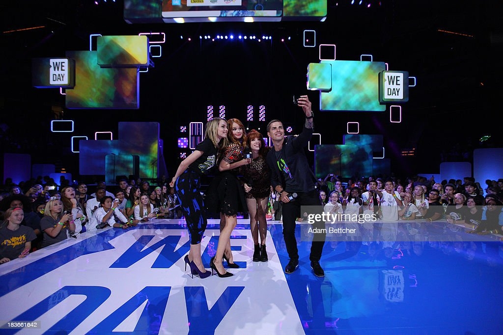 Co-hosts Bridgit Mendler, Debby Ryan, Carly Rae Jepsen and Jesse Giddings take a self portrait during the We Day Minnesota event at the Xcel Energy Center in St. Paul, Minnesota on October 8, 2013