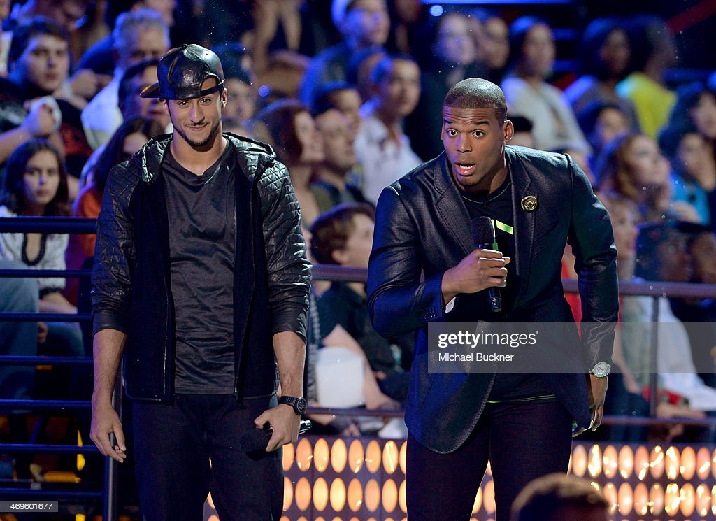Co-hosts Colin Kaepernick (L) and Cam Newton speak onstage during Cartoon Network's fourth annual Hall of Game Awards at Barker Hangar on February 15, 2014 in Santa Monica, California.