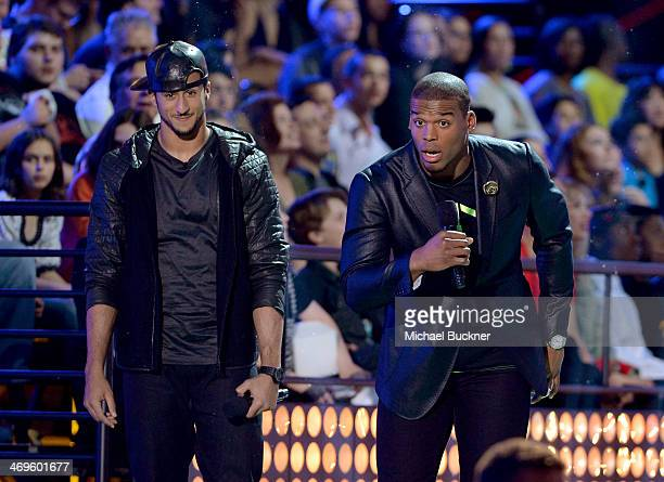 Cohosts Colin Kaepernick and Cam Newton speak onstage during Cartoon Network's fourth annual Hall of Game Awards at Barker Hangar on February 15 2014...