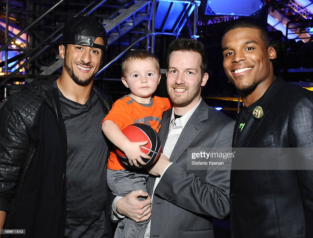 Co-hosts Colin Kaepernick (L) and Cam Newton (R) with Titus Ashby and Joseph Ashby attend Cartoon Network's fourth annual Hall of Game Awards at Barker Hangar on February 15, 2014 in Santa Monica, California.