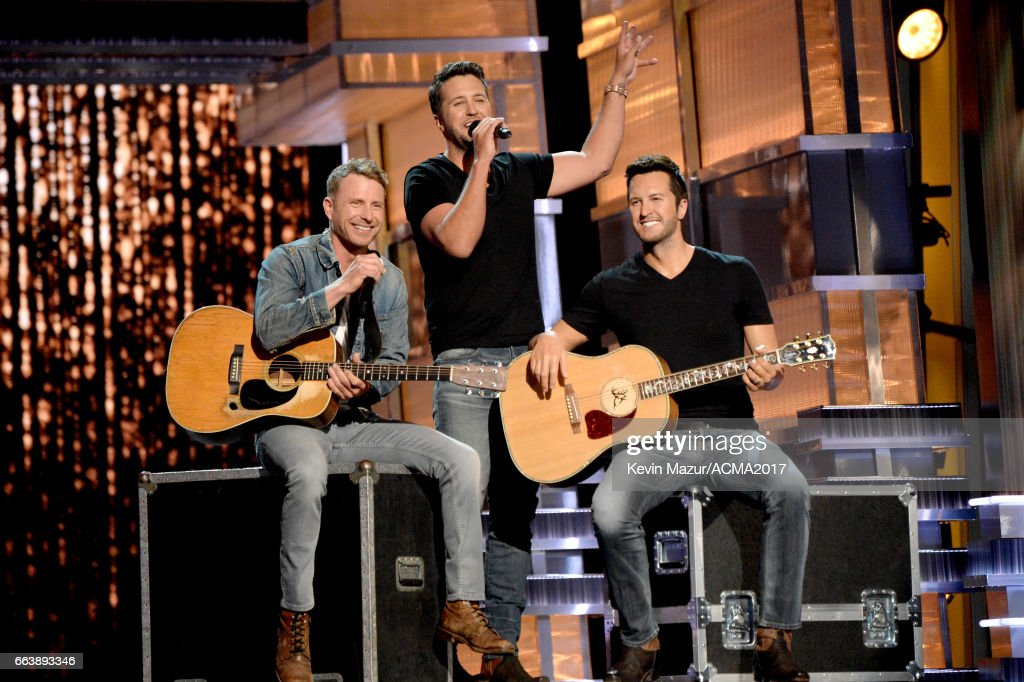 Co-hosts Dierks Bentley (L) and Luke Bryan speak next to a wax figure (holding guitar) of Luke Bryan onstage during the 52nd Academy of Country Music Awards at T-Mobile Arena on April 2, 2017 in Las Vegas, Nevada.