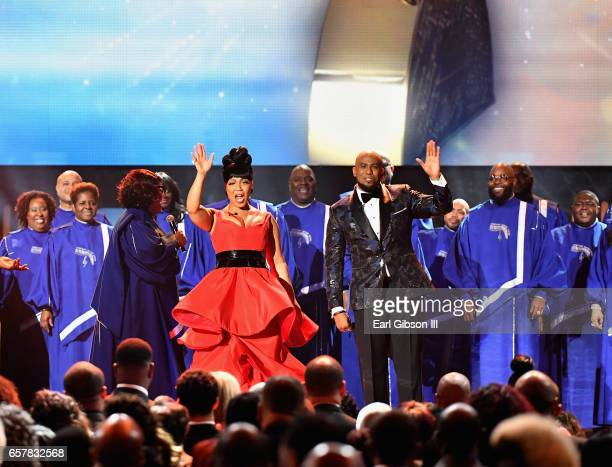 Cohosts Erica Campbell and Anthony Brown wave to the audience as The Chicago Mass Choir performs during the 32nd annual Stellar Gospel Music Awards...