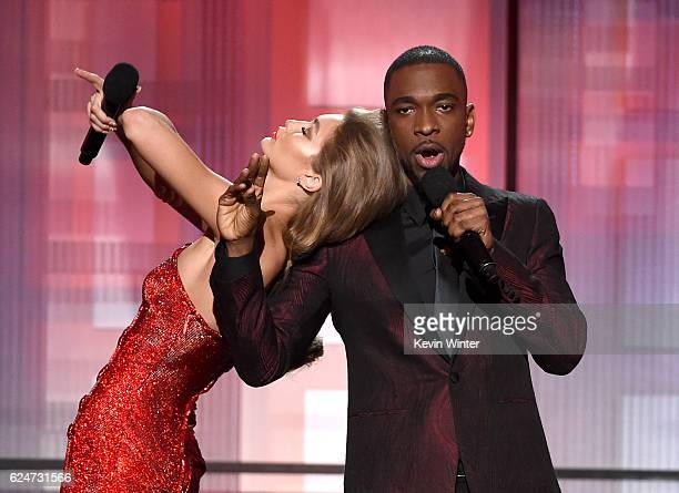 Cohosts Gigi Hadid and Jay Pharoah speak onstage during the 2016 American Music Awards at Microsoft Theater on November 20 2016 in Los Angeles...
