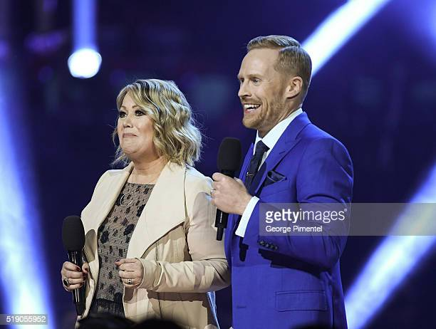 Cohosts Jann Arden and Jon Montgomery attend the 2016 Juno Awards at Scotiabank Saddledome on April 3 2016 in Calgary Canada