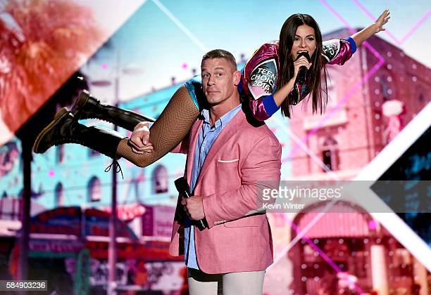 Cohosts John Cena and Victoria Justice speak onstage during Teen Choice Awards 2016 at The Forum on July 31 2016 in Inglewood California