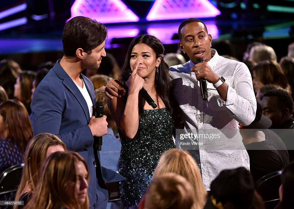 Co-hosts Josh Peck, Gina Rodriguez and Ludacris speak onstage during the Teen Choice Awards 2015 at the USC Galen Center on August 16, 2015 in Los Angeles, California.