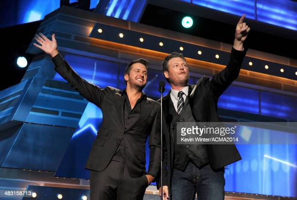Cohosts Luke Bryan and Blake Shelton speak onstage during the 49th Annual Academy of Country Music Awards at the MGM Grand Garden Arena on April 6...