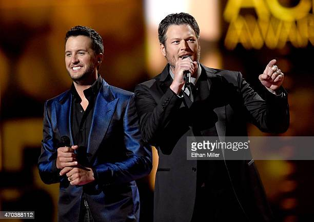 Cohosts Luke Bryan and Blake Shelton speak onstage during the 50th Academy of Country Music Awards at ATT Stadium on April 19 2015 in Arlington Texas