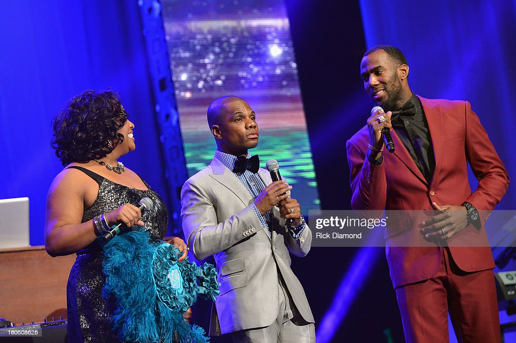 Co-hosts Sherri Shepherd and Kirk Franklin speak onstage with Malcolm Jenkins of the New Orleans Saints at the Super Bowl Gospel 2013 Show at UNO Lakefront Arena on February 1, 2013 in New Orleans, Louisiana.