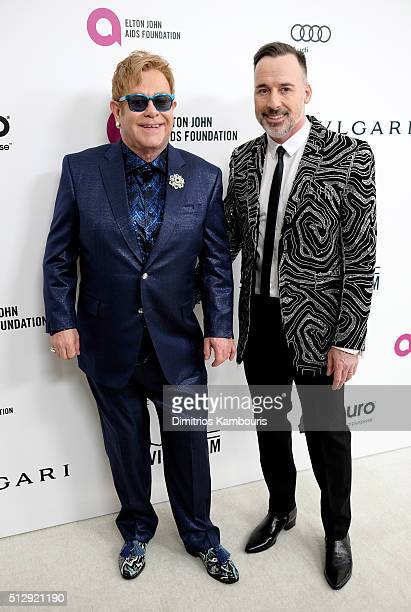 Cohosts Sir Elton John and David Furnish attend the 24th Annual Elton John AIDS Foundation's Oscar Viewing Party at The City of West Hollywood Park...