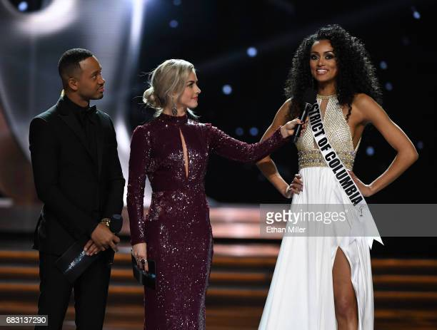 Cohosts Terrence J and Julianne Hough look on as Miss District of Columbia USA 2017 Kara McCullough answers a question during the interview portion...