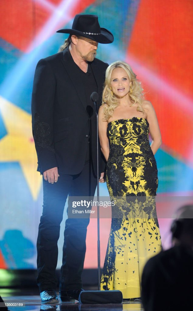 Co-Hosts Trace Adkins (L) and <a gi-track='captionPersonalityLinkClicked' href=/galleries/search?phrase=Kristin+Chenoweth&family=editorial&specificpeople=207096 ng-click='$event.stopPropagation()'>Kristin Chenoweth</a> speak onstage at the American Country Awards 2011 at the MGM Grand Garden Arena on December 5, 2011 in Las Vegas, Nevada.