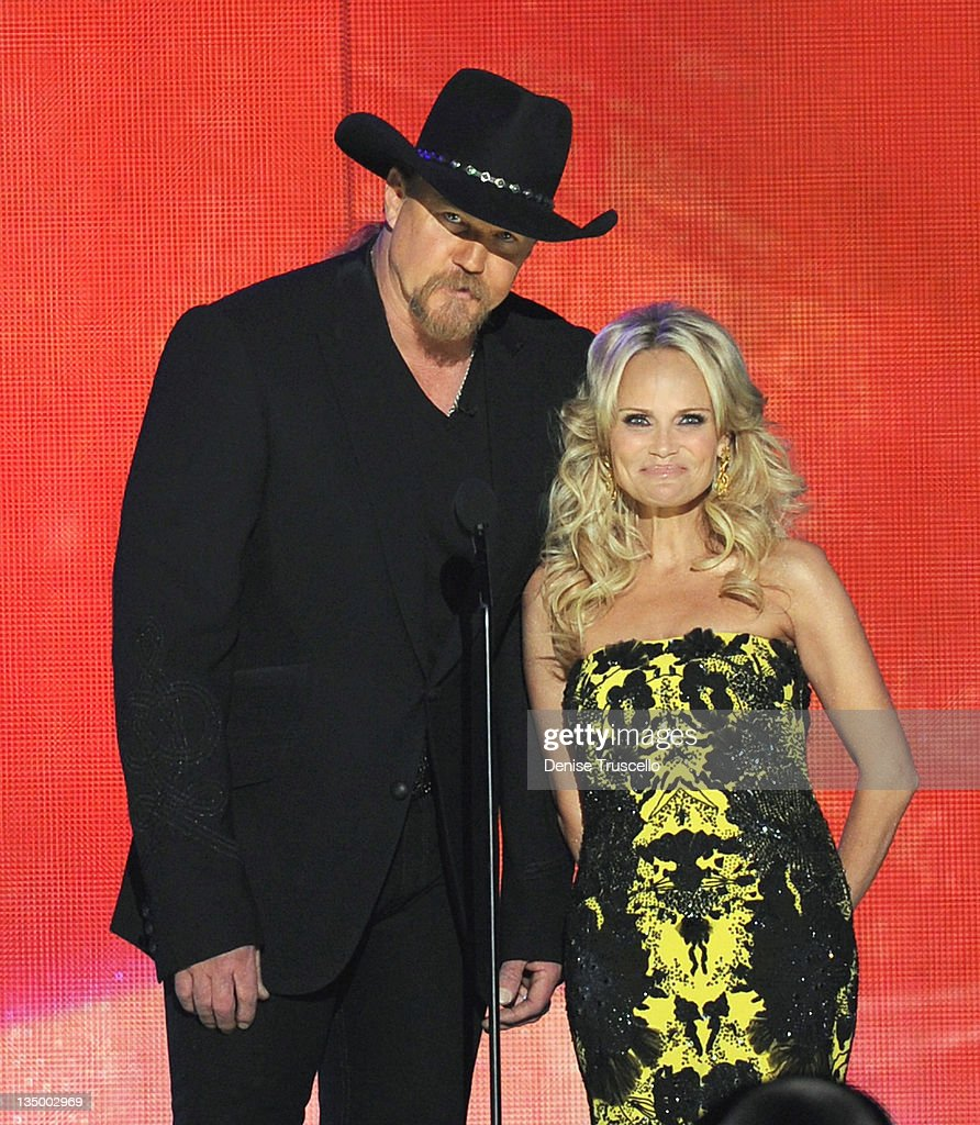Co-hosts <a gi-track='captionPersonalityLinkClicked' href=/galleries/search?phrase=Trace+Adkins&family=editorial&specificpeople=224686 ng-click='$event.stopPropagation()'>Trace Adkins</a> and <a gi-track='captionPersonalityLinkClicked' href=/galleries/search?phrase=Kristin+Chenoweth&family=editorial&specificpeople=207096 ng-click='$event.stopPropagation()'>Kristin Chenoweth</a> speak onstage during the 2011 American Country Awards at MGM Grand Garden Arena on December 5, 2011 in Las Vegas, Nevada.