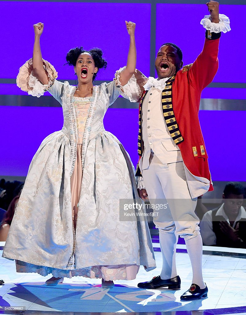 Co-hosts <a gi-track='captionPersonalityLinkClicked' href=/galleries/search?phrase=Tracee+Ellis+Ross&family=editorial&specificpeople=211601 ng-click='$event.stopPropagation()'>Tracee Ellis Ross</a> (L) and <a gi-track='captionPersonalityLinkClicked' href=/galleries/search?phrase=Anthony+Anderson&family=editorial&specificpeople=202577 ng-click='$event.stopPropagation()'>Anthony Anderson</a> perform onstage during the 2016 BET Awards at the Microsoft Theater on June 26, 2016 in Los Angeles, California.