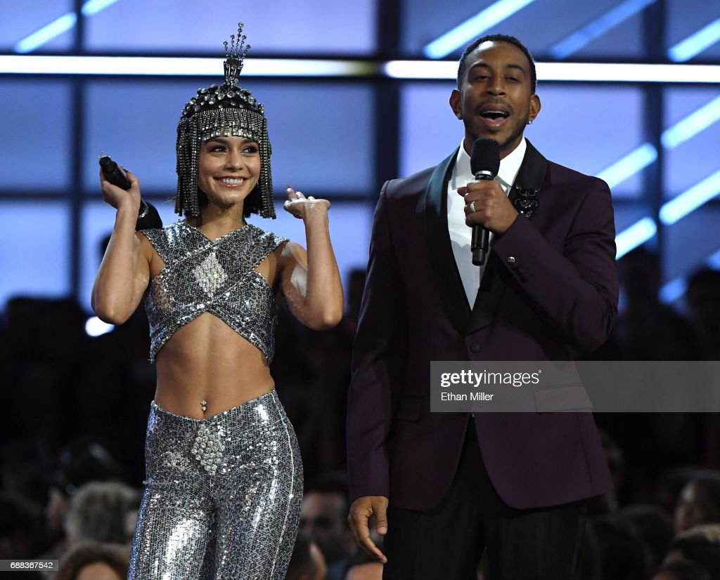 Co-hosts Vanessa Hudgens (L) and Ludacris speak during the 2017 Billboard Music Awards at T-Mobile Arena on May 21, 2017 in Las Vegas, Nevada.