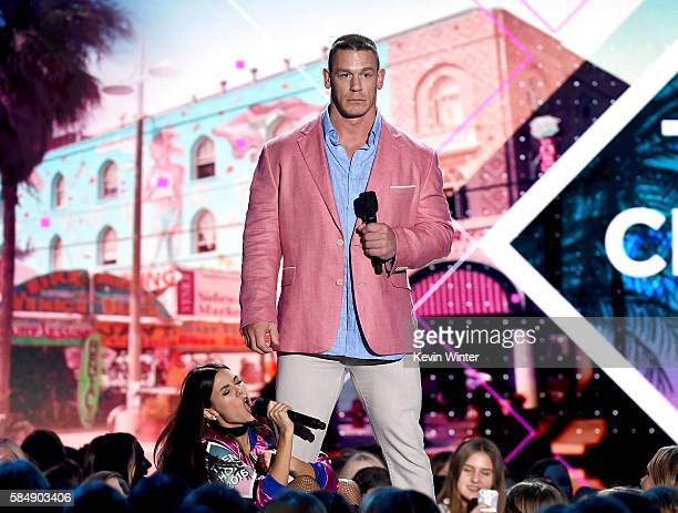 Cohosts Victoria Justice and John Cena speak onstage during Teen Choice Awards 2016 at The Forum on July 31 2016 in Inglewood California