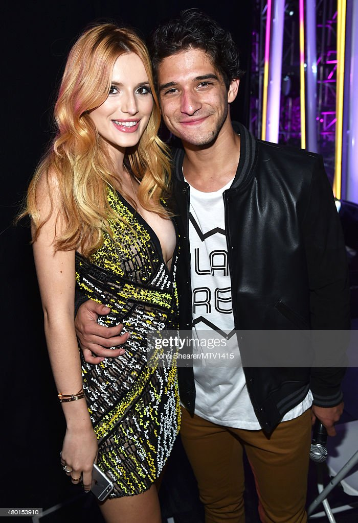 Cohosts/actors Bella Thorne and Tyler Posey attend the MTV Fandom Awards San Diego at PETCO Park on July 9 2015 in San Diego California