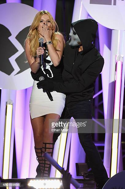 Cohosts/actors Bella Thorne and Tyler Posey perform onstage during the MTV Fandom Fest San Diego ComicCon at PETCO Park on July 9 2015 in San Diego...