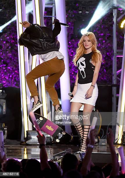 Cohosts/actors Tyler Posey and Bella Thorne perform onstage during the MTV Fandom Fest San Diego ComicCon at PETCO Park on July 9 2015 in San Diego...